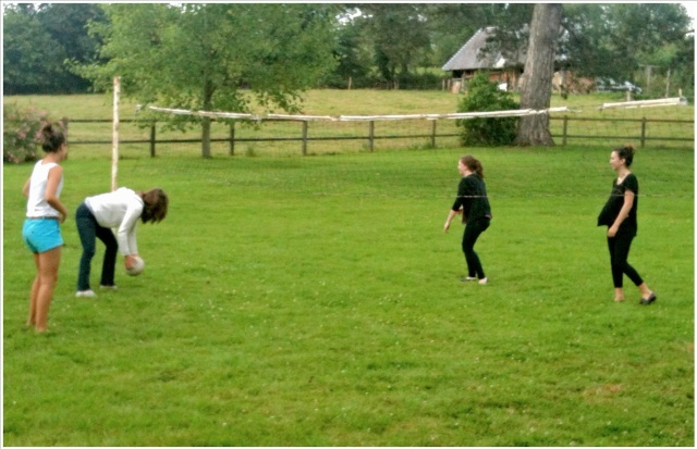 Celeste, Melinda, Ella & Chloe* attempt a volleyball game in the Bertail backyard.