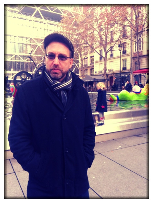 After not sleeping well during the night, I conked out in the morning and slept until past 2pm. As such, I didn't join the others for today's outing and don't have any new photos to share. You get this one, taken by Ella last Sunday near the Pompidou. Nice looking guy, don't you think?