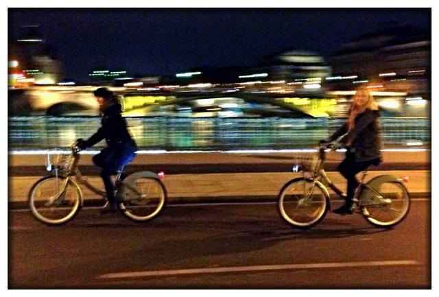 Oh, what fun it is for Melinda and Chloe to ride bikes over the Seine just past midnight on Christmas!