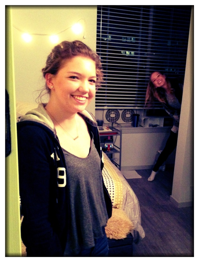 Ella, at the door of her new micro-apartment in Portland (with a ghost peaking in the background).