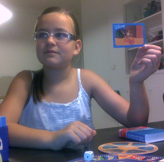 I found this in my archive of photos from the sabbatical. It's from late summer 2010, over 5 years ago, when we had first met Celeste. We were at her house in Nantes and she was playing some kind of Disney card game with Chloe and Ella. Priceless!