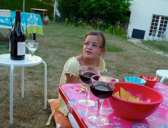 To go along with the photo I posted on Thursday night, I present this one of Celeste from 2010. It's from a dinner party in her backyard, one of the first whole gang get-togethers we had with the Bertails during the sabbatical. Bérnard grilled hamburgers....