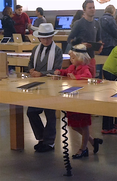Halloween 2015 is officially behind us, but I still want to offer this photo. On Saturday, Melinda & I took Celeste to University Village to see all the cute little kids in their adorable costumes. I spotted these two time travelers inside the Apple Store.