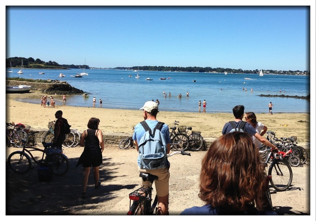Arriving at one of the beaches by bike. That's Laurent with the white hat.