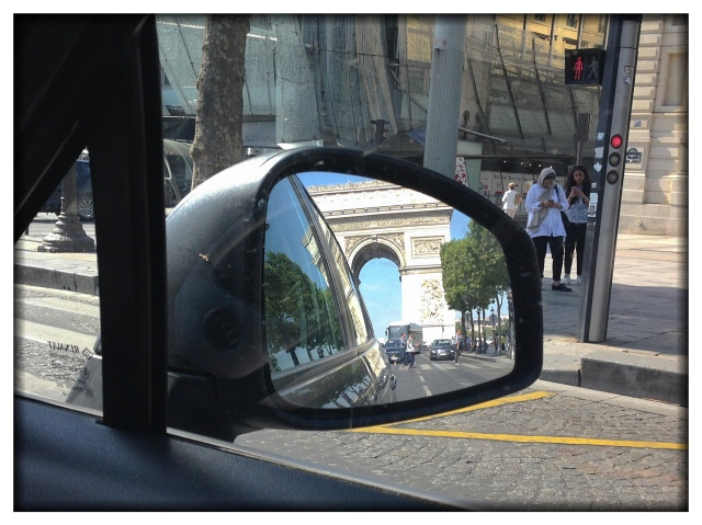 To prove we came by car to Paris, I offer this photo that I took out the passenger side window of the side mirror.  Yes, that's the Arc de Triomphe. Yes, we are driving on the Champs-Elysees.