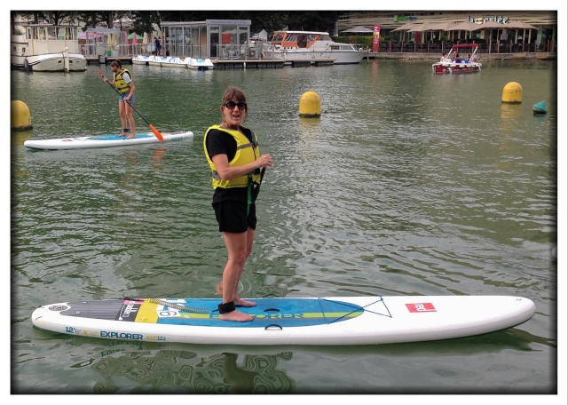 You decide if this is surprising or not. Melinda discovered a place that let her check out a paddle board for free. So there she is, in a dress, on a paddle board in Paris. She even talked Christine, Bernard, and Celeste to go with her. In fact, that's Celeste in the background in the upper left.