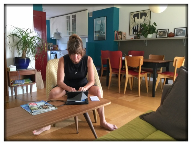 On a more upbeat note, here is Melinda in our living room just a few minutes ago. We are creating a debrief document of this year's trip and she is being the scribe.